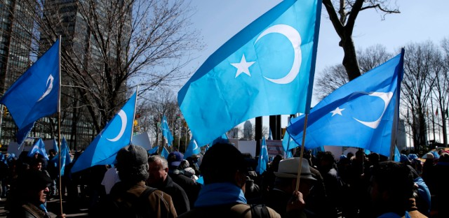 Uighurs and their supporters rally across the street from United Nations headquarters in New York, Thursday, March 15, 2018. Members of the Uighur Muslim ethnic group held demonstrations in cities around the world on Thursday to protest a sweeping Chinese surveillance and security campaign that has sent thousands of their people into detention and political indoctrination centers.