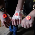 Justin Worst, Marlo Webber and Jes Waldrip show off an LED light implant. Grindhouse Wetware calls it the Northstar.
