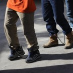 Unauthorized immigrants leave a court in shackles in McAllen, Texas. More than 40,000 immigration court hearings have been canceled since the government shut down. John Moore/Getty Images