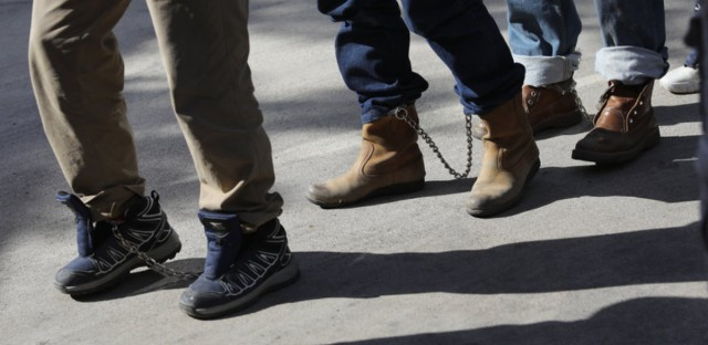 Unauthorized immigrants leave a court in shackles in McAllen, Texas. More than 40,000 immigration court hearings have been canceled since the government shut down. (John Moore/Getty Images)