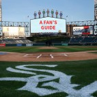 """Guaranteed Rate Field with the scoreboard edited to read """"A Fan's Guide"""""""