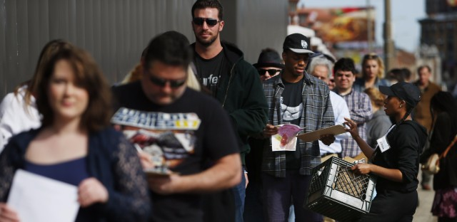 People wait in line in Allston, Mass., on March 13 for an open casting call for Patriots Day, a feature film about the Boston Marathon bombing. Jessica Rinaldi/Boston Globe via Getty Images