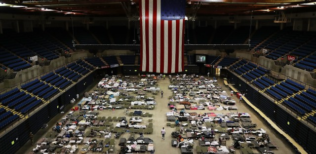 Evacuees seek temporary shelter in The Baton Rouge River Center arena in Baton Rouge, La., on Friday, after floodwaters destroyed or damaged tens of thousands of homes in the southeast part of the state.