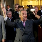 "Nigel Farage, the leader of the UK Independence Party, celebrates and poses for photographers as he leaves a ""Leave.EU"" organization party for the British European Union membership referendum in London."