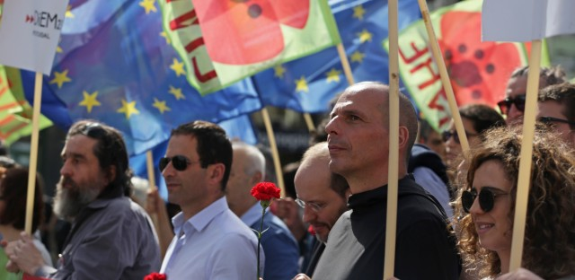 Former French Socialist presidential candidate Benoit Hamon, center left, and former Greek Finance Minister Yanis Varoufakis, center right, participate in the annual parade in Lisbon marking Portugal's 1974 Carnation Revolution, which toppled a dictatorship and brought democracy, Wednesday, April 25 2018. Varoufakis has launched a new anti-austerity party that will run against the governing left-wing Syriza party in Greece's next general election.