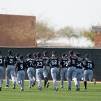 Chicago White Sox minor league players run during spring training baseball practice in Glendale, Ariz., Saturday, Feb. 22, 2014.