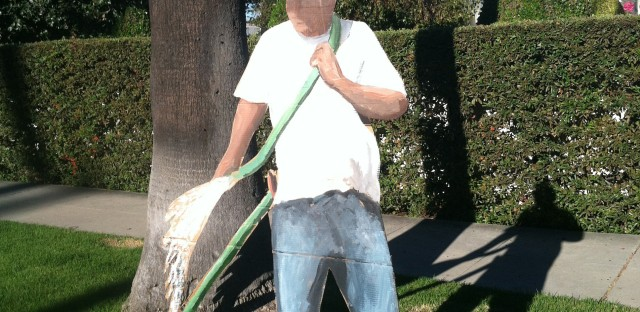 "Gomez makes life-size cardboard cutouts of laborers — such as this ""gardener"" on North Beverly Drive — and leaves them on manicured lawns."