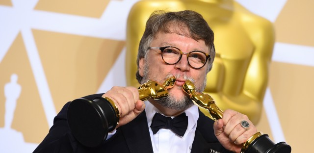 """Guillermo del Toro, winner of the awards for best director for """"The Shape of Water"""" and best picture for """"The Shape of Water"""", poses in the press room at the Oscars on Sunday, March 4, 2018, at the Dolby Theatre in Los Angeles."""