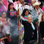 Mexico's new President Andres Manuel Lopez Obrador, center, participates in a traditional indigenous ceremony at the Zocalo, in Mexico City, Saturday, Dec. 1, 2018. Mexicans are getting more than just a new president Saturday. The inauguration of Lopez Obrador will mark a turning point in one of the world's most radical experiments in opening markets and privatization.