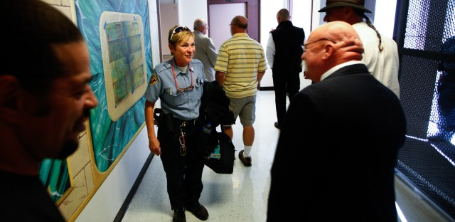 On the way to the meeting, prison guard Sgt. Pamela Bornhoft greets Boley, a former inmate at the facility. While he was still incarcerated, she had encouraged him to enter the program that's designed to help those aging in prison adapt to the outside world upon their release.