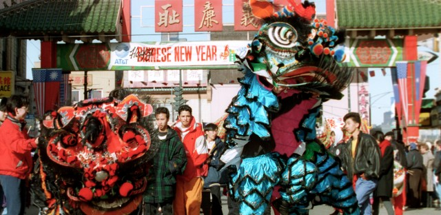 dragon dancers lead the parade through the streets of Chicago's Chinatown