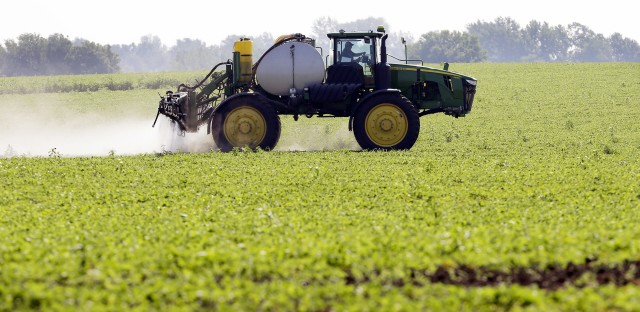 A farmer sprays a soybean field in Granger, Iowa. There's new and detailed data on the impact of genetically modified crops on pesticide use. Those crops replaced insecticides, and, at first, some herbicides. But herbicide use has rebounded.