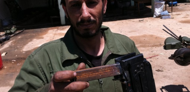 Libyan Rebels Restore Old Weapons, Wait For New