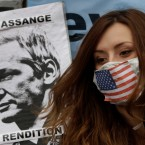 A supporter of WikiLeaks founder Julian Assange sits outside the Ecuadorian Embassy, in London, Friday, June 22, 2012. Assange entered the embassy on Monday in an attempt to gain political asylum to prevent him from being extradited to Sweden to face allegations of sex crimes, which he denies. In a telephone interview with the Australian Broadcasting Corporation (ABC) from inside the embassy, the 40-year-old Australian said he did not know when the decision would be made.