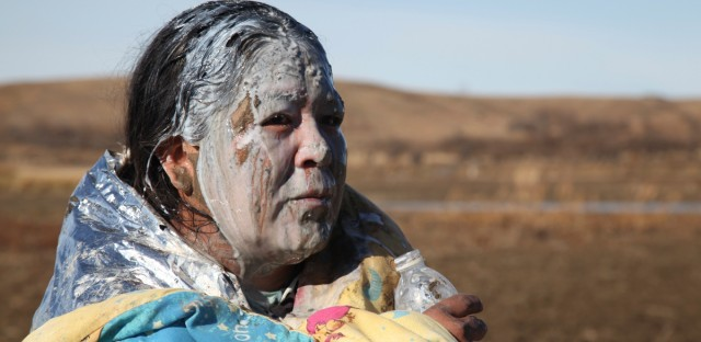 Tonya Stands recovers after being pepper sprayed by police after swimming across a creek with other protesters hoping to build a new camp to block construction of the Dakota Access Pipeline