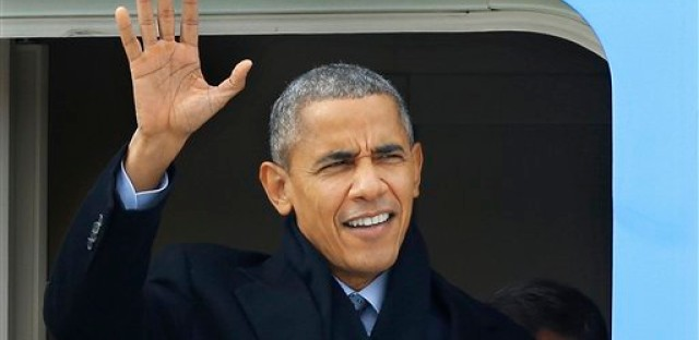 President Barack Obama waves as he arrives on Air Force One at Abraham Lincoln Capital Airport, Wednesday, Feb. 10, 2016, in Springfield, Ill. Obama returns to his political birthplace with a plea to a joint session of the Illinois General Assembly for better politics.