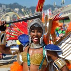One of the samba dancers performs prior to the start of women's Marathon race of the Rio 2016 Olympic Games Athletics o in Rio de Janeiro, Brazil, Sunday, Aug. 14, 2016. (Zsolt Czegledi /MTI via AP)