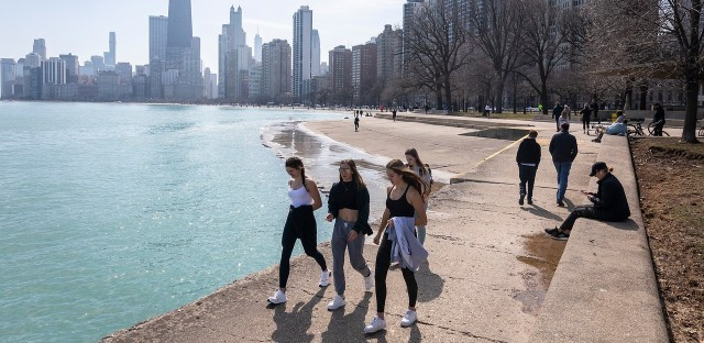 People walk along Chicago's Lakefront