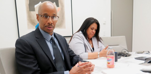 Patrick Pursley and his fiancee, Michelle Carr, talk in his attorney's office in Chicago about how reexamination of ballistic evidence helped him get a new trial for a 1994 murder he says he didn't commit. The case marks the first time someone has gotten a new trial by using a ballistics software that investigators have been using to put countless criminals behind bars. Pursley is free on bail and living with his fiancee while he waits for a new trial.