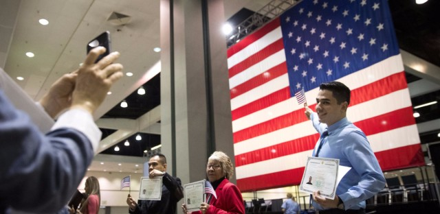 Immigrants pose with U.S citizenship certificates