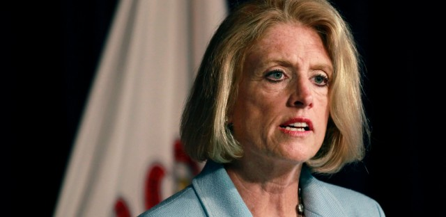In this June 10, 2015 file photo, Illinois state Comptroller Leslie Munger speaks at a news conference in Chicago. Munger's office said Monday, Aug. 24, 2015, it's unable to pay social service agencies as directed by a court order because it can't find the funds. The comptroller writes Illinois' checks and has been ordered to pay agencies by courts while Gov. Bruce Rauner and lawmakers are deadlocked on a budget causing a cash shortage.