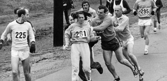 """In 1967, Kathrine Switzer was spotted early in the Boston Marathon by race director Jock Semple, who tried to rip the number off her shirt and remove her from the race. Switzer's friends intervened, allowing her to make her getaway to become the first woman to """"officially"""" run the Boston Marathon."""