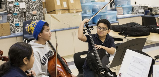 Carlos Garcia (right) chats with other students during the Sound Minds after-school program at Downer Elementary.