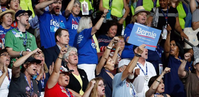 Supporters of Bernie Sanders chanted his name and booed mentions of Hillary Clinton on Monday, the first day of the Democratic National Convention, in Philadelphia.