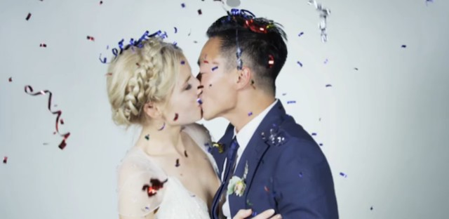 Still from a viral video by newlyweds Quang and Ellie, who had a slow-motion video booth for guests at their wedding reception.