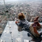 "Five-year-old Anna Kane looks down from ""The Ledge,"" at Chicago's 110 story, 1,450 foot Willis Tower on June 24, 2009. The glass balcony is suspended 1,353 feet in the air and juts out 4 feet from the Sears Tower's 103rd floor Skydeck."