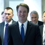 Supreme Court nominee Judge Brett Kavanaugh walks to meet with senators on Capitol Hill last month. He faces days of questioning from senators beginning Tuesday.