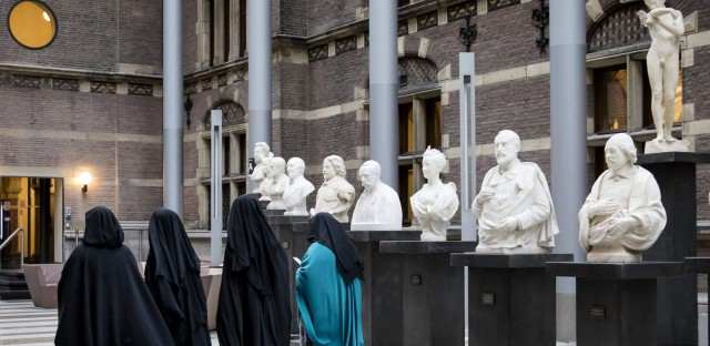 A European court has sided with employers who restrict Muslim women from wearing Islamic headscarves. Here, women wearing niqab visit the Dutch Senate last November, as restrictions on Islamic head coverings were being debated.