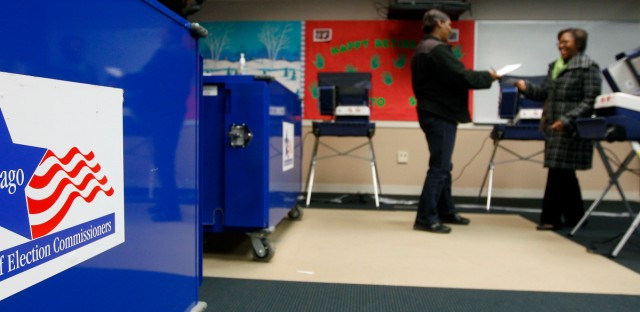 An election worker hands a voting receipt to a voter at a polling station in Chicago. A federal judge has scaled back Election Day voter registration for highly populated areas in Illinois, a decision that sides with Republicans who claimed in a lawsuit that last year's extension of same-day registration is unconstitutional.