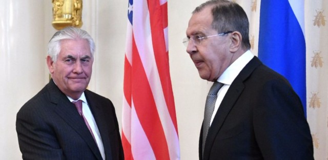 Secretary of State Rex Tillerson shakes hands with Russian Foreign Minister Sergei Lavrov at the start of their meeting in Moscow. Russia has accused the U.S. of breaking international law with its missile strike on Syria last week.