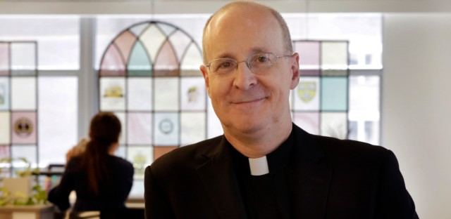 Father James Martin, a Jesuit priest and editor at large of America Magazine, poses for photos at the publication's offices in New York in this 2018 file photo.