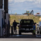 The CAFE standards that set fuel efficiency marks for the auto industry will be reopened for review, the Trump administration says. Here, vehicles refuel at a roadside gas station in New Mexico.