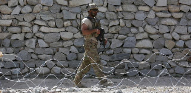 A U.S. soldier patrols in Asad Khil village near the site of a U.S. bombing in the Achin district of Jalalabad, east of Kabul, Afghanistan. As the administration of President Donald Trump plans to send more troops to Afghanistan, the 16-year war grinds on in bloody stalemate.