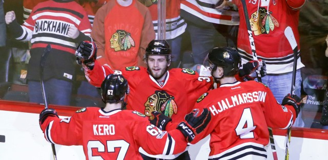 Chicago Blackhawks' Ryan Hartman, center, celebrates his goal with Tanner Kero (67) and Niklas Hjalmarsson, during the first period of an NHL hockey game against the Buffalo Sabres Thursday, Jan. 5, 2017, in Chicago.