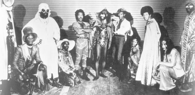 Bernie Worrell, Grady Thomas, unident., Fuzzy Haskins, George Clinton, Tiki Fulwood, unident., Michael Hampton, unident., Calvin Simon of the funk band Parliament-Funkadelic pose for a portrait in circa 1974.