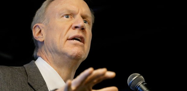 """In this March 4, 2015 file photo, Illinois Gov. Bruce Rauner speaks at an event in Springfield, Ill. Rauner's office has instructed state agencies to begin diverting """"fair share"""" fees from nonunion members' paychecks away from unions."""