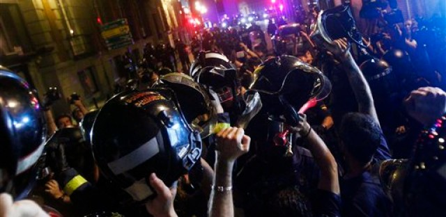Firefighters hold up their helmets during a protest against austerity measures announced by the Spanish   government in Madrid, Spain, Thursday July 19, 2012.