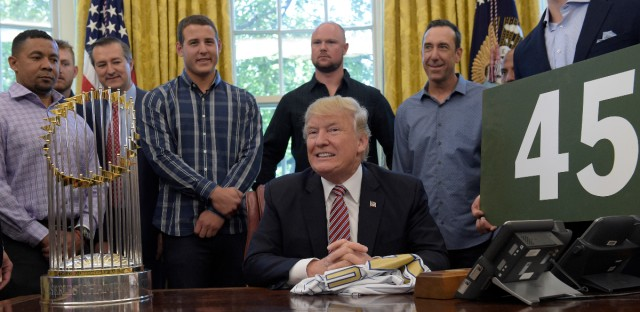 President Donald Trump pauses as he is asked a question on health care as he meets with members of the 2016 World Series Champions Chicago Cubs, Wednesday, June 28, 2017, in the Oval Office of the White House in Washington.
