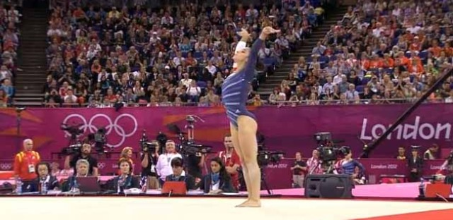 Raisman, with her arms up.