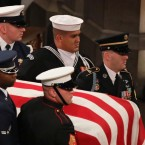 A military honor guard carries the casket of former President George H.W. Bush during the funeral at the National Cathedral in Washington, D.C.