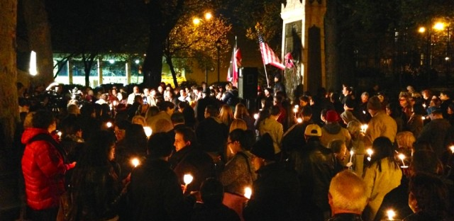 Brooklyn leaders gathered in Carroll Park for a vigil that featured the flags of France, Kenya, Lebanon and the United States.