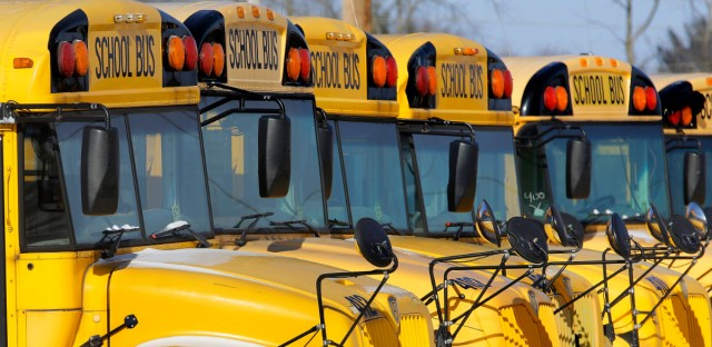 Public school buses are parked in Springfield, Ill. in this January 2015 photo (AP Photo/Seth Perlman)