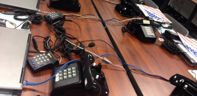 Scores of phones wait for election day workers to answer questions for the March primary