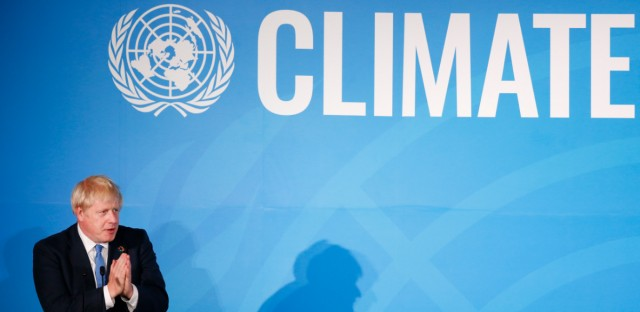 Britain's Prime Minister Boris Johnson addresses the Climate Action Summit in the United Nations General Assembly, at U.N. headquarters, Monday, Sept. 23, 2019.