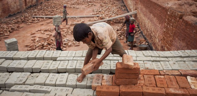 Babu, 8, works at a brick factory in Narayanganj, Bangladesh.