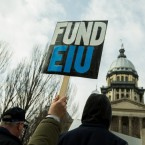 protestors with fund eiu signs
